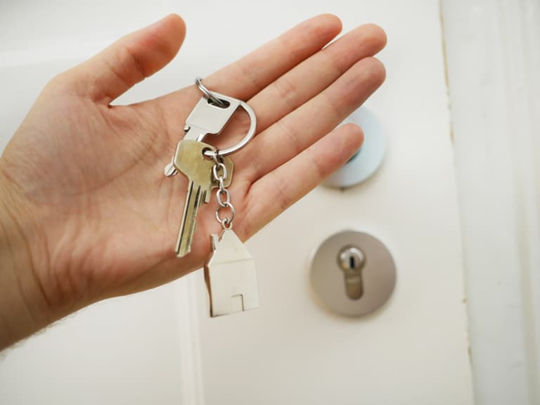 A set of keys in a man's hand.